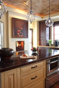 I love this Santa Fe, NM home, pt 3: there is a tiny fireplace in the kitchen to add a feeling of intimacy.