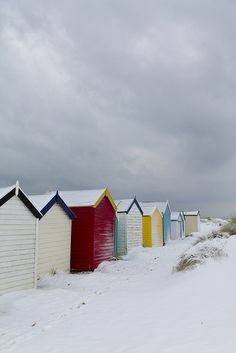 winter snow on the Beach Huts at Southwold, Suffolk, England, UK