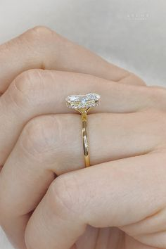 This elegant custom engagement ring features a delicate hidden halo of diamonds that wraps around the center stone. Schedule a consultation to learn more about designing this diamond ring style. Rectangle Engagement Rings, Oval Solitaire Engagement Ring, Elegant Engagement Rings, Engagement Ring Styles, Wedding Ring Styles, Solitaire Gold Engagement Ring, Solitaire Diamond, Gold Wedding Rings, Oval Diamond