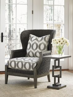 Woven water hyacinth gives this chair a distinct, yet attractive look. Customize from 200+ fabrics. #LHBDesign