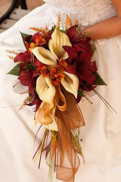 How romantic are these warm fall wedding colors? We adore this wedding bouquet. Featured Bouquet: ISLANDBRIDALCOMPANY via Etsy - use a tartan ribbon instead of the organza. Fall Wedding Flowers, Fall Flowers, Wedding Colors, Orange Flowers, Lily Wedding, Orange Wedding Flower Arrangements, Autumn Wedding Bouquet, Autumn Bride, Spring Wedding