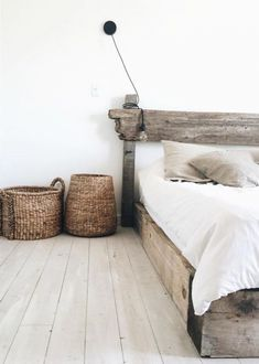 Beachy, warm, minimal bedroom with custom rustic chic greyed wood bed, bleached hardwood floor, and natural woven baskets. White duvet and natural linen pillow shams keep it monochromatic and lovely. Rustic Bedroom Design, Home Decor Bedroom, Bedroom Ideas, Master Bedroom, Rustic Bedrooms, Bedroom Girls, White Bedroom, Bedroom Designs, Bedroom Furniture