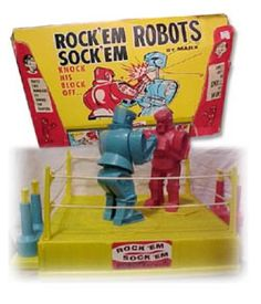Rock'em Sock'em Robots these were awesome!!! I played with these all the time, didn't care if I was a girl I played with my little brother.