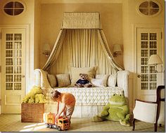 Charlotte Moss bedroom...I love the built-ins on either side of the bed, with french doors. Fabric conceals any clutter in the closets.