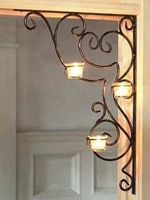 These elegant brackets look lovely in the corner of a doorway or window, plus romantic scrolls and flickering candlelight add ambience to your decorating. Three votive cups on each bracket provide the perfect mood lighting. Wrought Iron Decor, Home And Deco, Metal Art, Decoration, Living Room Decor, Dining Room, Sconces, Candle Holders, Interior Decorating