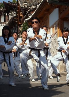 "A taekwondo team performs their own rendition of the international hit ""Gangnam Style"" in Bukchon Hanok Village."