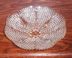 THIS IS A LOVELY HAZEL ATLAS CLEAR TEARDROP 4-TOED BOWL OR SERVING NAPPY MEASURING APPROXIMATELY 6 1/2 ROUND X 1 5/8 HIGH. GREAT FOR SERVING NUTS, MINTS, CANDY, ETC. THE BOWL IS IN EXCELLENT CONDITION WITH NO CHIPS, CRACKS, REPAIRS, OR CLOUDING. VERY NICE DEPRESSION ERA BOWL DISCONTINUED