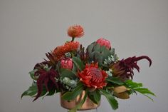 Mix of natives in red - waratah, pincushions, proteas, leucadendrons. This beauty will last for weeks.