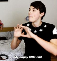 Danisnotonfire what is he doing?! :] and does anyone else see a baby doll in the background? Lol :)