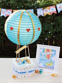 Inventive moms are going beyond the one-, two-, and three-tiered creations by molding the Pampers into new structures from baskets to tricycles. We've rounded up 33 of our favorites that you can use as inspiration for your own inedible confections.