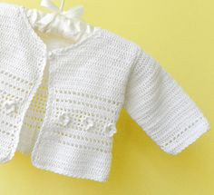 Light crocheted baby vest in white with by Svetlanababyknitting