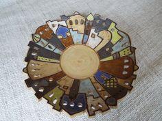Die Schale ist dekoriert mit einer orientalischen Häusersilhouette und eignet sich sehr gut als Obstschale.    Die Schale wurde bei 1220 °C gebrannt und hat einen Durchmesser von ca. 23 cm und...