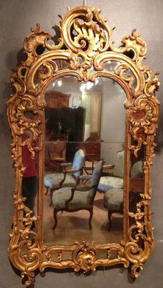 Very fine, French, early Louis XV period mirror: In solid carved giltwood with parcloses. With original giltwood surface and original mercury glass. Circa: 1735.