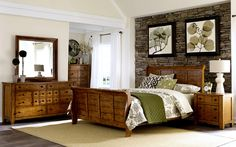 Sinking Springs Bedroom Collection. • The Sinking Springs bedroom collection offers everything you need to create your own personal bedroom retreat.  • Each piece is crafted  in a classic oak .  • This bed features sturdy headboard and foot-board rails with center supported slat system.  • In addition, two matching nightstands, a solid dresser with mounted mirror , chest and media chest . Click On Picture For More Collections
