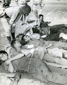File:Wounded-on wayto-hospital-RG-208-AA-158-A-015.jpg Patton talking to wounded soldiers being evacuated