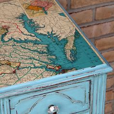 it or Pass: Map Furniture Mod Podge a map to a tabletop. A cool way to cover damaged wood. Perfect for my old bench that I just got.Mod Podge a map to a tabletop. A cool way to cover damaged wood. Perfect for my old bench that I just got. Do It Yourself Furniture, Diy Furniture, Painted Furniture, Decoupage Furniture, Vintage Furniture, Decoupage Coffee Table, Refurbishing Furniture, Furniture Design, Chair Design
