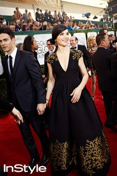 JULIANNA MARGULIES looks radiant in Andrew Gn while she walks, hand-in-hand, with her husband Keith Lieberthal.