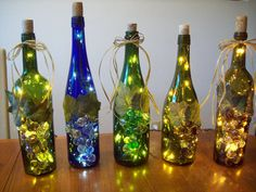Upcycled Wine Bottle Lamp - so pretty! Use empty wine bottles and strings of lights, add 'grapes' and leaves on the front.