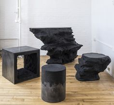 Stools made from black silica and black cement by AMMA Studio.
