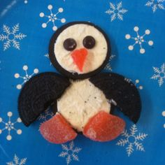 Simple penguin cookies. 2 Oreos (twisted open: 2 frosted sides for face & belly. 1 unfrosted side broken in 1/2 for wings), 2 mini m's for eyes, and 1 gummy orange slice (cut in 1/2 lengthwise, then cut -with clean scissors- that portion in 1/2 for feet, use other portion and snip a triangular beak). Easy and cute. My 2nd graders had trouble twisting the Oreos w/out breaking them, but we're creative in their 'repairs'.