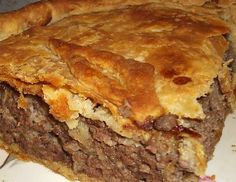 FRENCH MEATPIE Pie crusts for two pies 5-6 rustic potatoes-cooked and mashed-plain 2 lbs ground beef 1 lb ground pork 1 large onion diced 1 tablespn Poultry seasoning 1 tspn ground cloves 1 tablespn butter