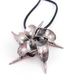 2004, Spiculum Anticlastic Pendant, made of sheet sterling silver and leather cord.  Valerie A. Heck Esmont valerieheck