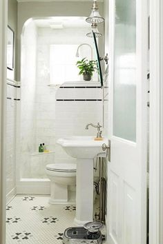 this is one of my all time favorite small bathrooms. black and white mosaic floor tile, frosted glass door, and classic pedestal sink. no shower curtain needed. bathroom ideas vintage Small Bathrooms by Design Style Bad Inspiration, Bathroom Inspiration, Bathroom Ideas, Bathroom Remodeling, Shower Ideas, Bathroom Layout, Bath Ideas, Tile Layout, Budget Bathroom