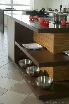 Idea of the Day: Not too dark, not too light. Medium-stained wood kitchens in modern styles. Nice, two tone medium wood dark wood zebrawood island sink Dark Wood Kitchen Cabinets, Dark Wood Kitchens, Brown Kitchens, Home Kitchens, Kitchen Wood, Kitchen Modern, Kitchen Ideas, Wood House Design, Wood Interior Design