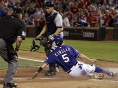 Texas Rangers' Ian Kinsler, bottom, scores on a Adrian Beltre single as home plate umpire Brian Runge, left, and New York Yankees catcher Russell Martin  look on in the sixth inning of a baseball game on Wednesday, April 25, 2012, in Arlington, Texas. (AP Photo/Tony Gutierrez) game 19, Rangers win to move to 15-4