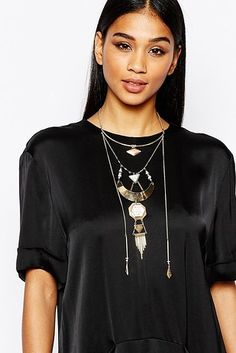 This gorgeous marble and gold geometric piece that will definitely turn heads. | 23 Statement Necklaces That Make Any Outfit Look Like You Tried