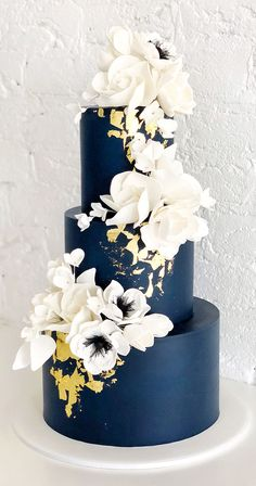 Rich navy, a touch of gold and sugar flowers ✨ This is the third time I've gotten to recreate this design, and I think it may be my… country chocolat mariage cake cake country cake recipes cake simple cake vintage Gold Wedding Colour Theme, Navy Blue Wedding Cakes, White And Gold Wedding Cake, Wedding Cakes With Flowers, Elegant Wedding Cakes, Beautiful Wedding Cakes, Wedding Cake Designs, Colourful Wedding Cake, Gold Wedding Cakes