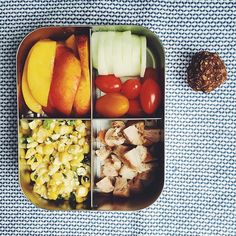 Leftovers make for the yummiest lunches! (Bbq chicken, basil-corn salad, cherry tomatoes, cukes, nectarines and a double choco nut-free lunchbox bite. Follow @kiwiandbean on Instagram for more great lunchbox inspiration.