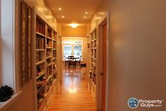 love the hallway with built in book cases!