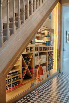 Cellar Maison's incredibly popular climate controlled under stairs wine wall. This bespoke classic wine wall combines concealed LED lighting with natural oak joinery and frameless glass to create a stunning display suitable for long term storage of wine. Cellar Maison are specialists in creating bespoke, climate controlled wine cellars and wine rooms tailored to suit your property, interior design, style and wine collection.