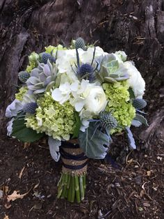 Bouquet with mini green and white hydrangeas, Eryngium, succulents and roses