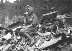 Lady drinking tea on the rubble caused by the Blitz