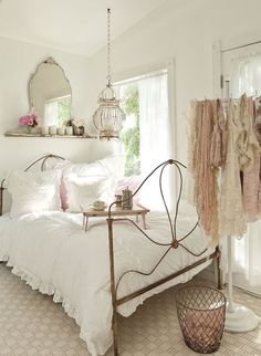 French inspired bedroom decor ... it's a feminine bedroom with lots of shabby and cottage chic touches.