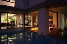 sleek-athens-house-blends-stone-with-concrete-textures-12-deck-inward-view-night.jpg