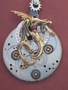 Dragons are so beautiful. <3   (Google Image Result for http://www.deviantart.com/download/134558550/lusty_gothic_Steampunk_Jewelry_by_clockwork_zero.jpg)