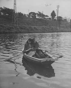 John Florea - US soldier and Japanese girl rowing on pond, Japan. 1946. S)