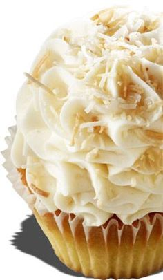 """Italian Cream Wedding Cupcakes  -  Italian Cream Cake topped with Cream Cheese Frosting and Toasted Coconut. Gigi's Cupcakes says: """"This Italian Cream Cake came from my great grandmother Nodini in Italy. She made this cake for all holidays and it was a must for good luck at weddings."""" - Gigi"""