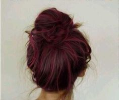 brown hair with purple-red highlights in a bun. SO PRETTY