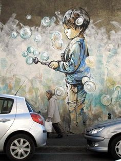 A fun piece of street art depicting a child in a cloud of bubbles. #graffiti #street #art STREET ART COMMUNITY » We declare the world as our canvas. www.moderncrowd.com/reverse-graffiti-street-art books, artists, street art utopia, food, pari, alic pasquini, blowing bubbles, mural, streetart