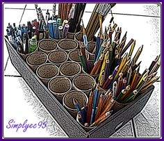 Im going to do this....so many colored pencils and markers! Recycled tissue rolls as pencil, pen and paint brush holders... such a great idea!