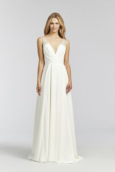 Dazhi-1651 Ivory chiffon A-line gown, draped V-neck crossover bodice, delicate beaded applique accenting the shoulders and low open back.