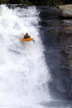 Kayak Going Over Triple Falls located in Dupont State Forest (Transylvania County, NC)