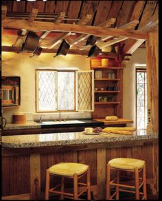 cob kitchen with wood ceiling and granite countertops