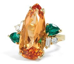 Imperial Topaz, Emerald Diamond Ring, late 20th century.  Almost teardrop in shape, the topaz is 11.26 carats.
