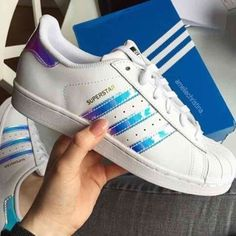 Superstar Adidas White Stripe hologram sneakers  These will fit women's 7 :) Low cut iridescent rainbow stripe white New sneakers in original box! I got them and they are not my color . Big kids 5.5/ mens 4.5/ women's 6.    These run big and fit women 7) ! I tried them on with socks once, and out right back into box. They are too small for me, I'm a 7.5. Adidas Shoes Sneakers