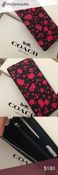 Coach Wallet Its a navy blue with hot pink design. I like neutral colors so i wanna give this a new home! Never used. Still in the box! Tags and everything with it. Coach Bags Wallets
